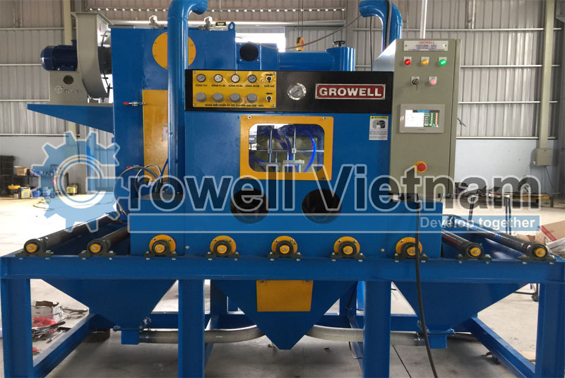 Compressed air shot blasting machine